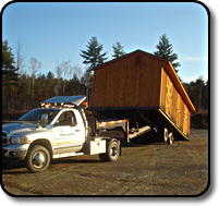 Using the specialized trailer to load a barn